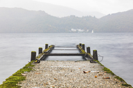 UK, Scotland, wreck of a pier going into a lake in the highlands - WPEF00693