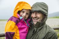 Father and daughter in rainproof jackets - CUF43127