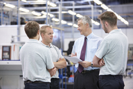 Workers and manager meeting in engineering warehouse - CUF43395