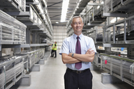 Portrait of manager in engineering warehouse - CUF43413