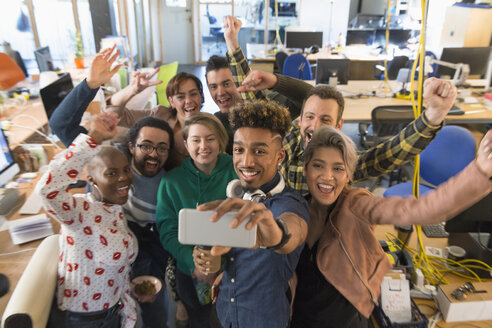 Enthusiastic creative business team cheering, taking selfie in office - CAIF21036