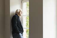 Portrait of senior man looking out of window - CUF43497