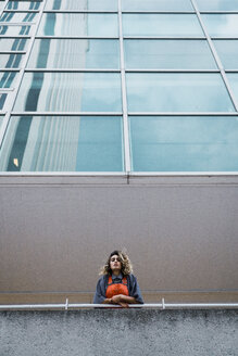 Beautiful woman leaning on railing of modern building - KKAF01223
