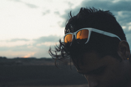 Young man with sunglasses looking down, silhouette - ACPF00142