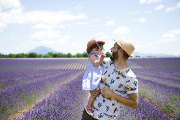 France, Provence, Valensole plateau, happy father and daughter in lavender fields in the summer - GEMF02125