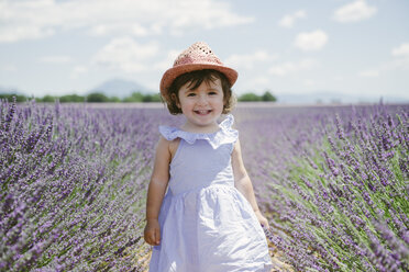 France, Provence, Valensole plateau, Happy toddler girl in purple lavender fields in the summer - GEMF02131