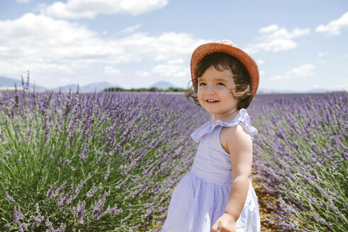 France, Provence, Valensole plateau, Happy toddler girl in purple lavender fields in the summer - GEMF02134