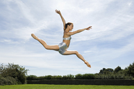 A young woman leaping in the air. Acrobat. - MINF00211
