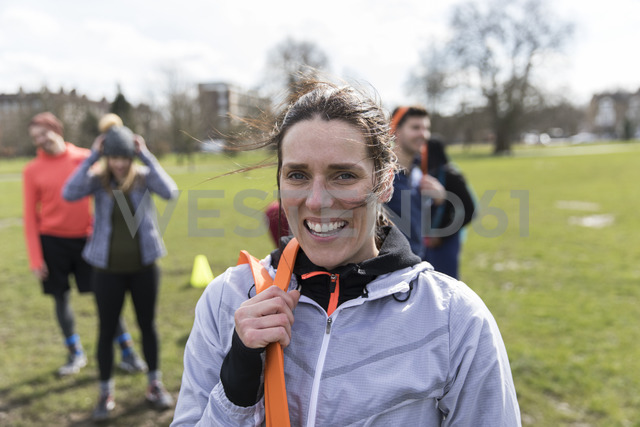 Portrait smiling, confident woman exercising in park - CAIF21198