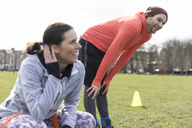 Man and woman exercising in park - CAIF21201