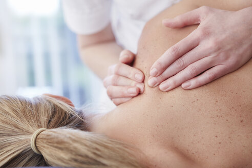 Woman receiving shoulder massage - CAIF21213