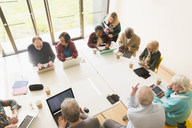 Senior business people using laptops and digital tablets in conference room meeting - CAIF21276