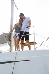 Mature couple making holidays, sailing on a catamaran - EBSF02668
