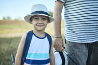 Portrait of smiling little boy wearing summer hat - ZEDF01471