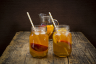 Two glasses of peach orange ice tea on wood - LVF07307