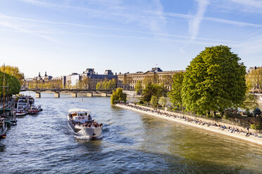 France, Paris, Tourist boat on Seine river with Louvre in background - WDF04711