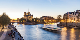 France, Paris, Tourist boat on Seine river with Notre Dame cathedral in background - WDF04717