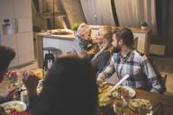 Family and friends enjoying dinner, eating, drinking, having fun - AWF00115