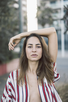 Portrait of woman wearing unbuttoned striped shirt - AFVF00856
