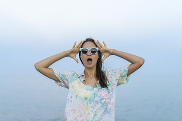 Portrait of scared woman in front of the sea - AFVF00865