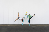 Two acrobats doing tricks on a ladder - AFVF00895