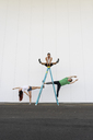 Three acrobats doing tricks on a ladder - AFVF00898