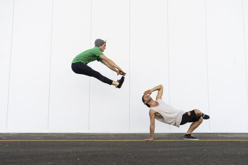 Two acrobats doing tricks together, jumping mid-air - AFVF00925