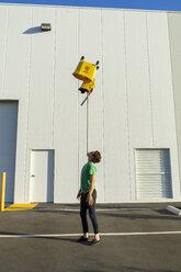 Acrobat balancing bucket on mop on his chin - AFVF00961