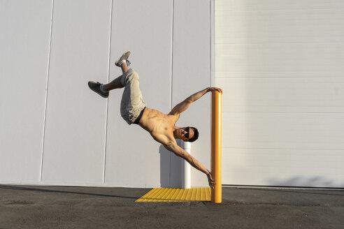 Acrobat training on a pole - AFVF00967