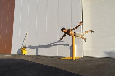 Acrobat training on a pole - AFVF00979