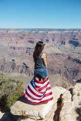 USA, Arizona, back view of woman with American flag enjoying view of Grand Canyon National Park - GEMF02175