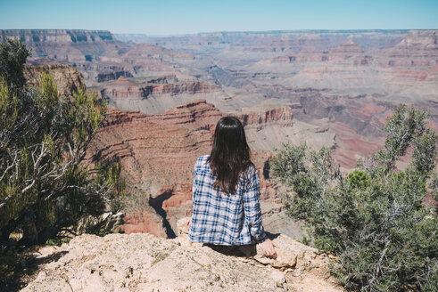 USA, Arizona, Grand Canyon National Park, Grand Canyon, back view of woman looking at view - GEMF02184