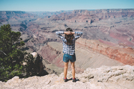 USA, Arizona, Grand Canyon National Park, Grand Canyon, back view of woman looking at view - GEMF02193