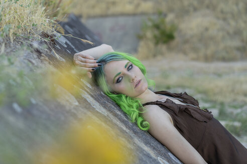 Portrait of young woman with dyed green hair and eyebrows in nature - AFVF01001