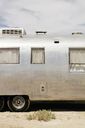 A vintage Airstream silver accommodation trailer parked on the Bonneville Salt Flats during Speed week. - MINF01204
