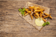 Hand made french fries with mayonnaise on wood, overhead view - NAF00105