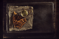 Hand made french fries with mayonnaise on baking paper, baking tray, overhead view - NAF00117