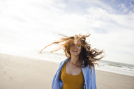 Portrait of a redheaded woman, laughing happily on the beach - KNSF04251