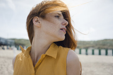Portrait of a redheaded woman on the beach - KNSF04308
