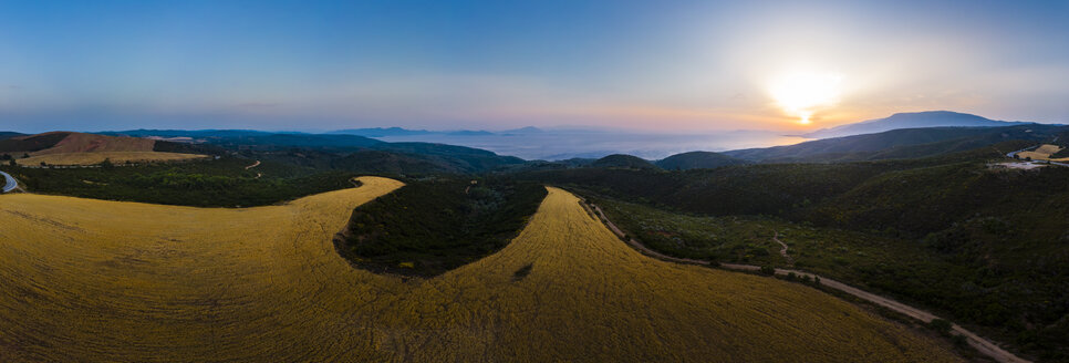 Greece, Region of Volos, Pagasetic Gulf, Peninsula Pelion, Aerial view over grain fields to Sound of Trikeri in the evening - AMF05845