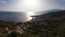 Greece, Aegean Sea, Pagasetic Gulf, Peninsula Pelion, Aerial view of Milina in the evening - AMF05886