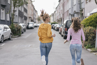 Two girlfriends having fun in the city, running - JOSF02397