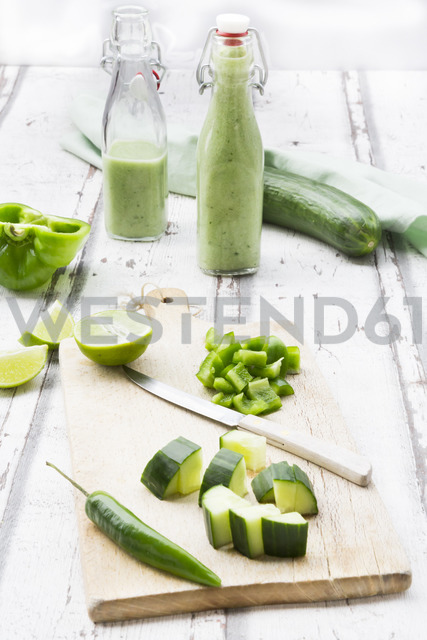 Glass bottle of homemade green Gazpacho and ingredients - LVF07329