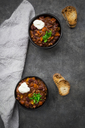 Two bowls of Chili con Carne with fresh coriander and sour cream - LVF07338