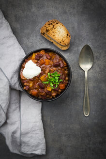 Bowl of Chili con Carne with fresh coriander and sour cream - LVF07341