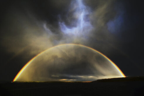 The arc of a rainbow over the landscape. - MINF02354