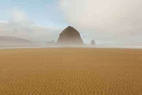 Lifting fog over Haystack Rock and Cannon Beach at dusk. - MINF02360