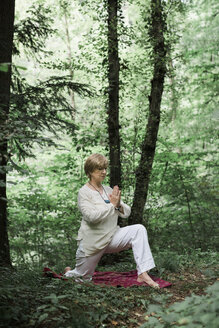 Senior woman doing yoga in the forest - ALBF00588