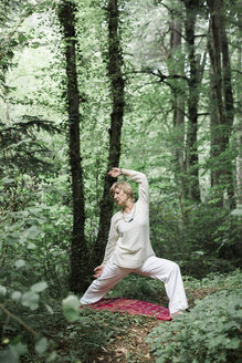 Senior woman doing yoga in the forest - ALBF00591