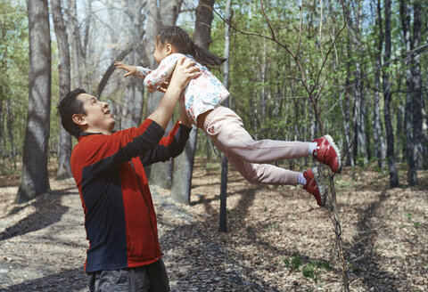 Father and daughter having fun in a park - AZF00028
